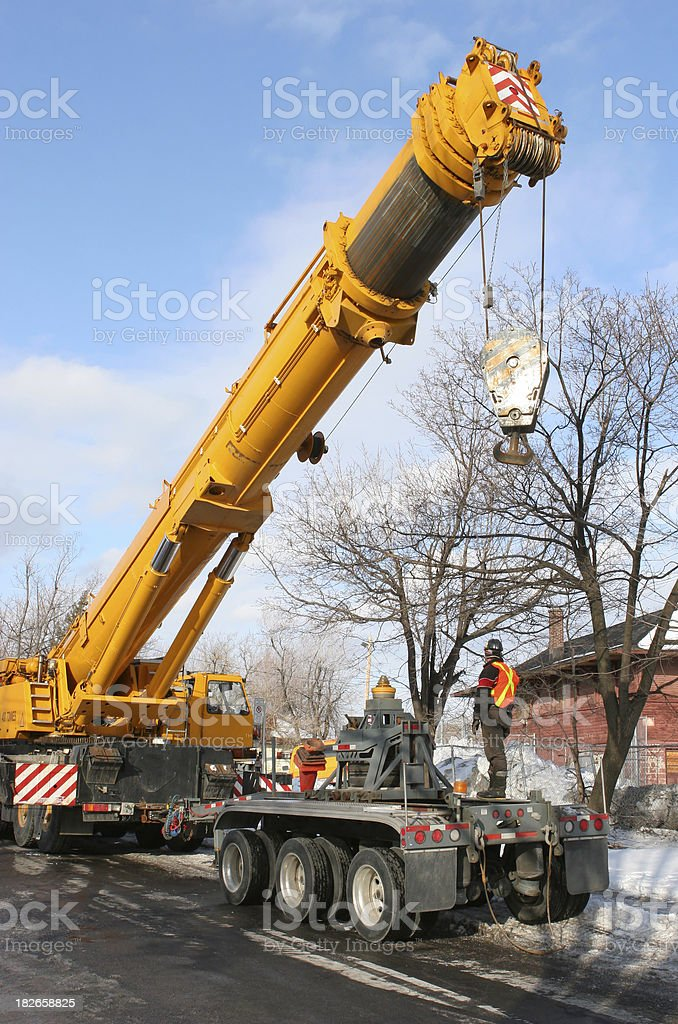 Heavy Mobile Crane and Workers stock photo