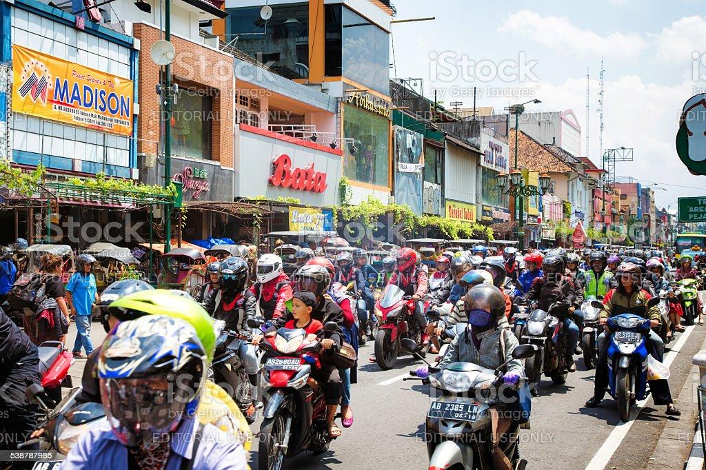 Heavy motorbike traffic downtown Yogyakarta Indonesia stock photo