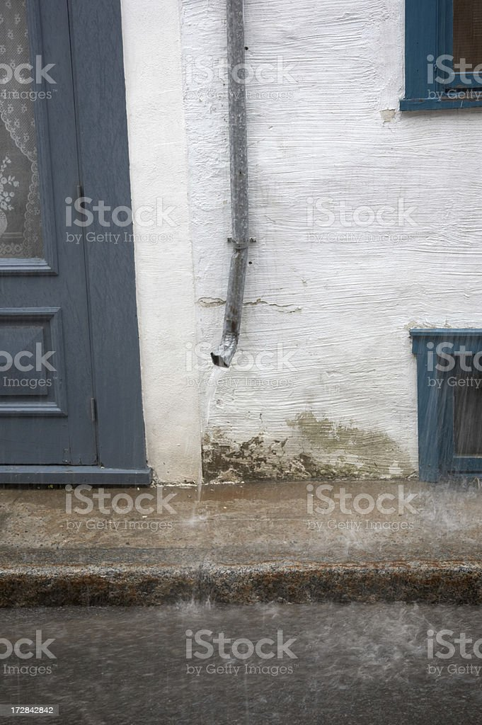 Heavy rain bouncing off asphalt royalty-free stock photo