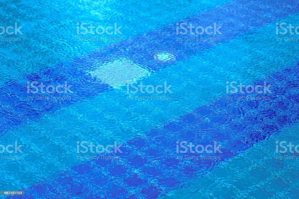 Heavy rain in the blue swimming pool stock photo