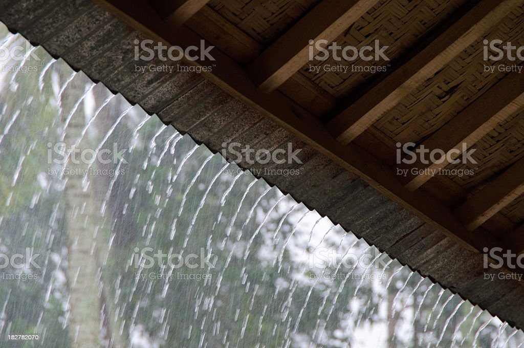 Heavy rain on rooftop seen from under it stock photo