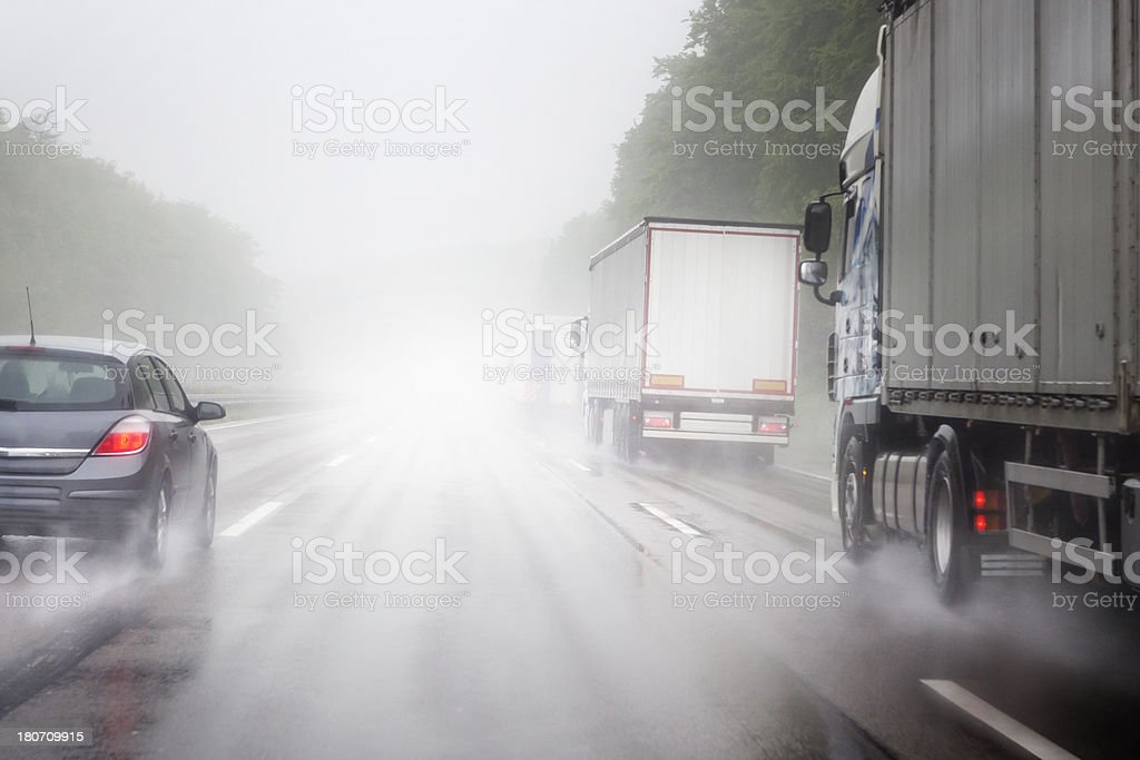 Heavy rain on the highway stock photo