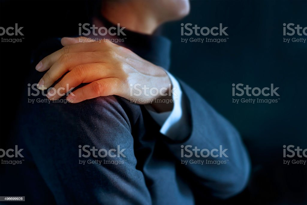 heavy shoulder pain of business woman colored in red stock photo