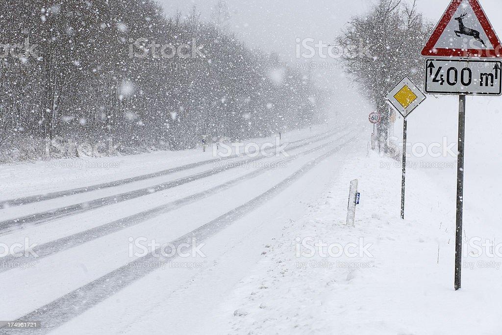 Heavy snowfall on german federal road royalty-free stock photo