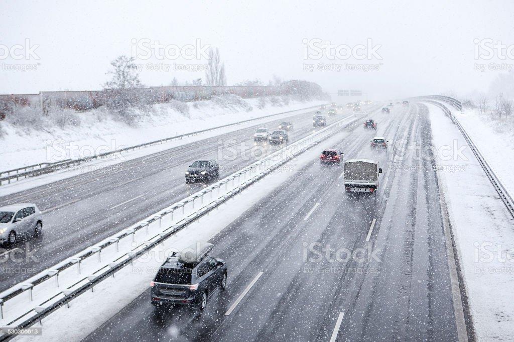Heavy snowfall on German highway stock photo