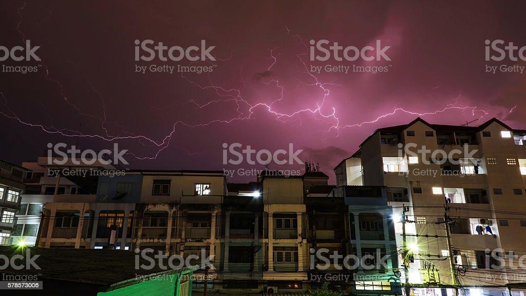 Heavy thunderstorm lightning over city stock photo