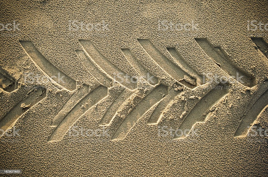 Heavy tire tracks in the sand at beach or desert stock photo