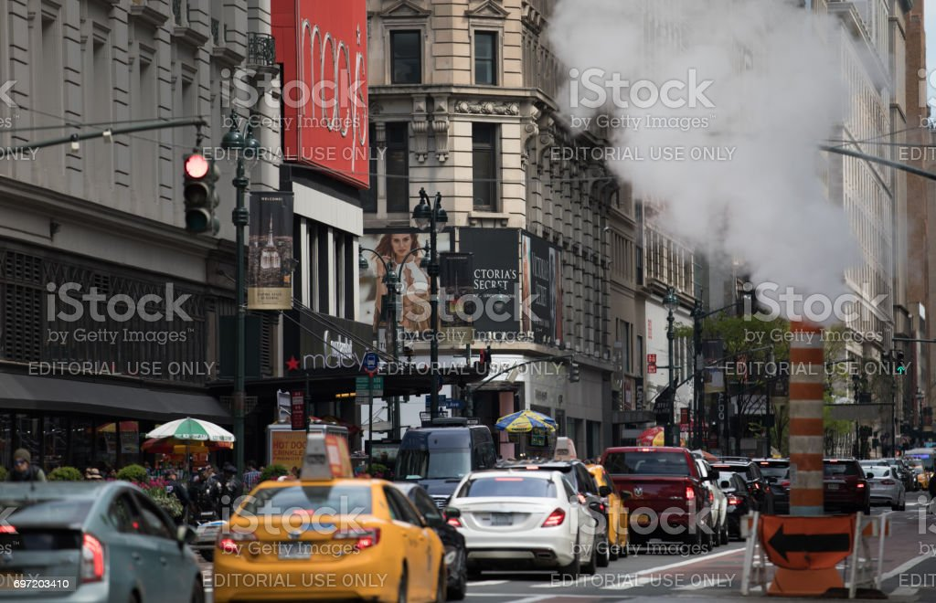 Heavy Traffic and Steam on 34th Street stock photo