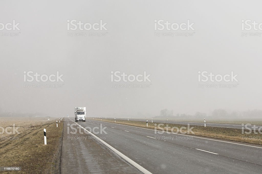 Heavy truck in foul weather stock photo