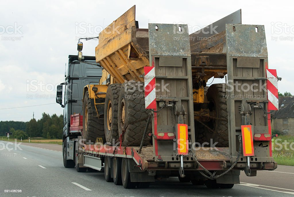 Heavy truck with trailer at highway. stock photo