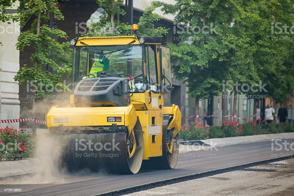 Heavy Vibration roller compactor at asphalt pavement works stock photo