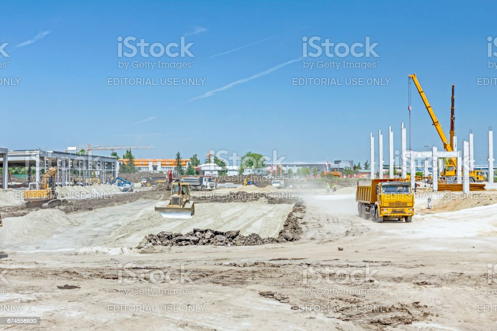 Heavy wheels are working at construction site stock photo