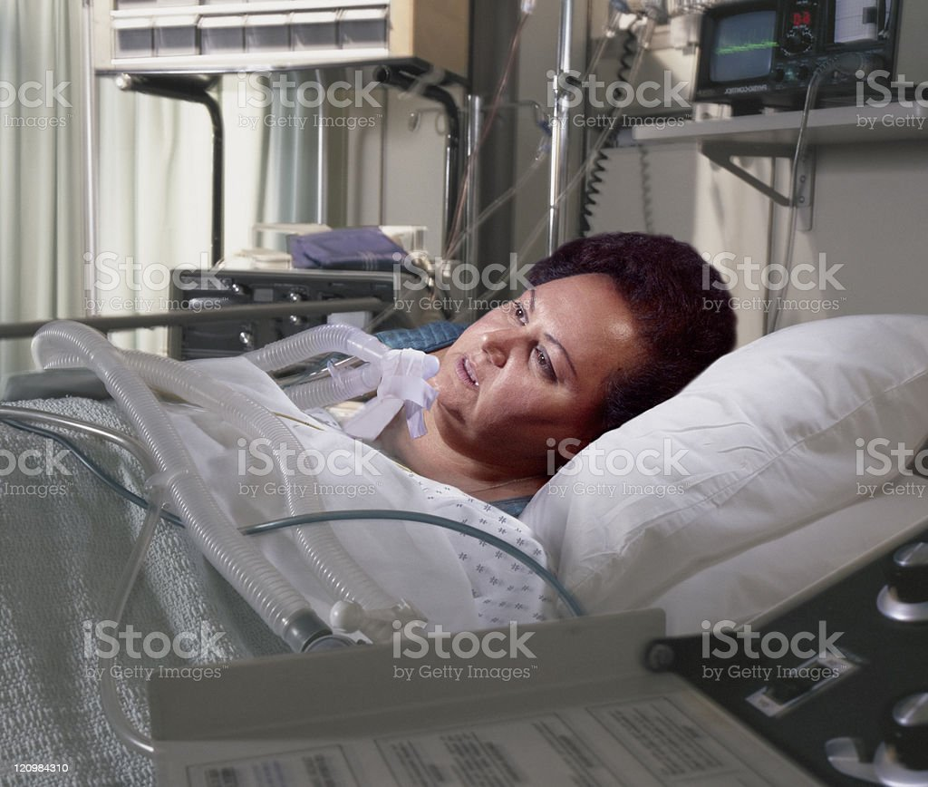 heavy woman in hospital bed stock photo