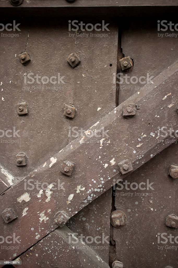 Heavy wooden door of temple in Asia studded with bolts stock photo
