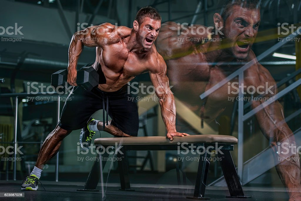Heavy Workout at the gym stock photo