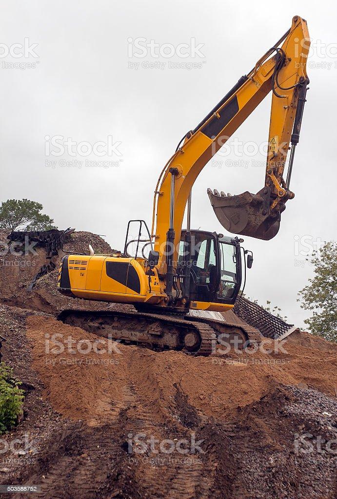 heavy yellow excavator stock photo