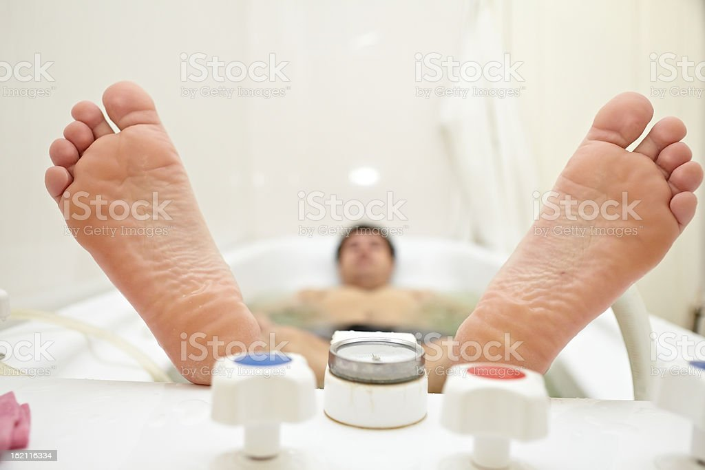 Heels lying person in the bath stock photo