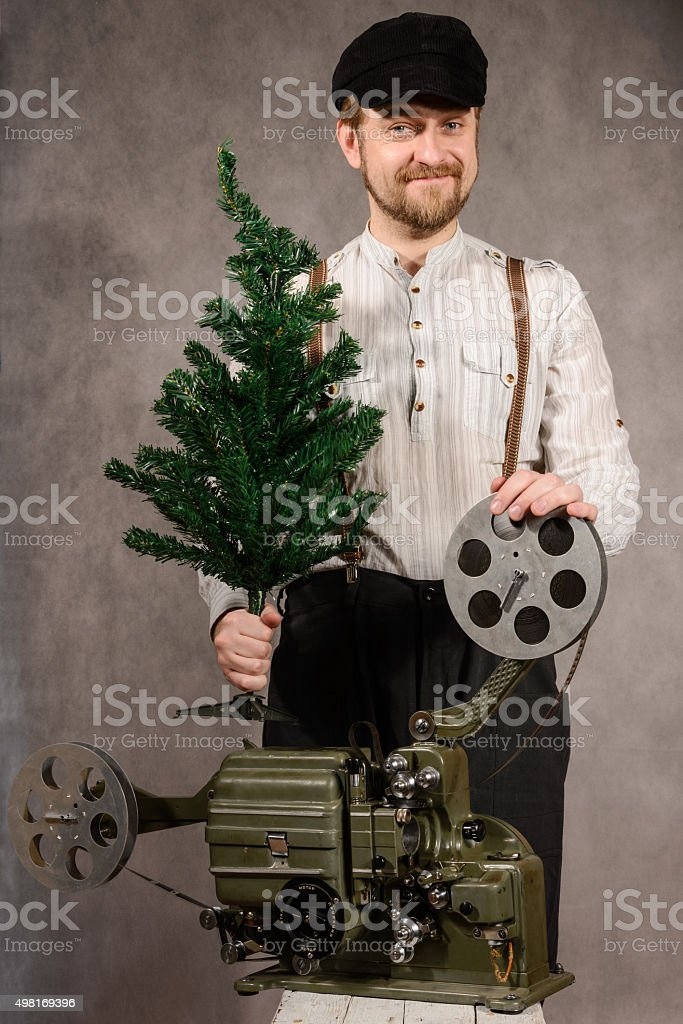 ?heerful projectionist with ?hristmas tree in their hands stock photo