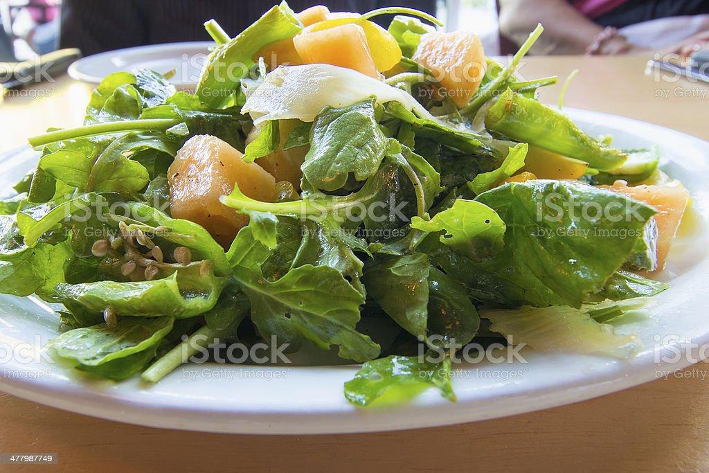 Heirloom Melons with Arugula Green Salad stock photo