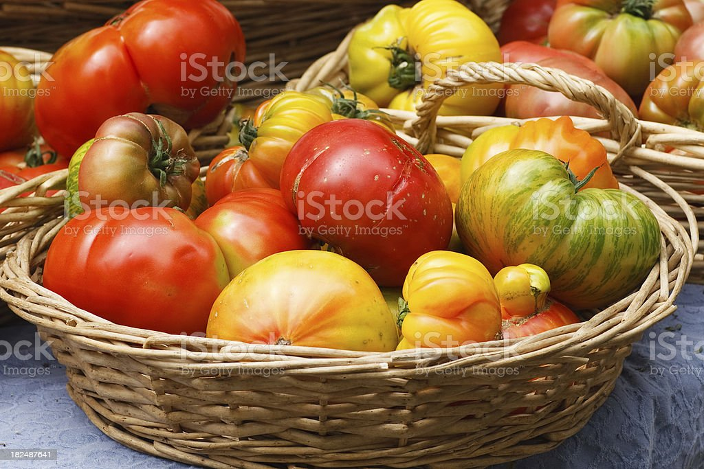 heirloom tomatoes at farmers market stock photo