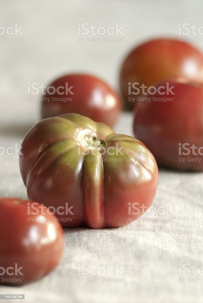Heirloom tomatoes on the tablecloth royalty-free stock photo