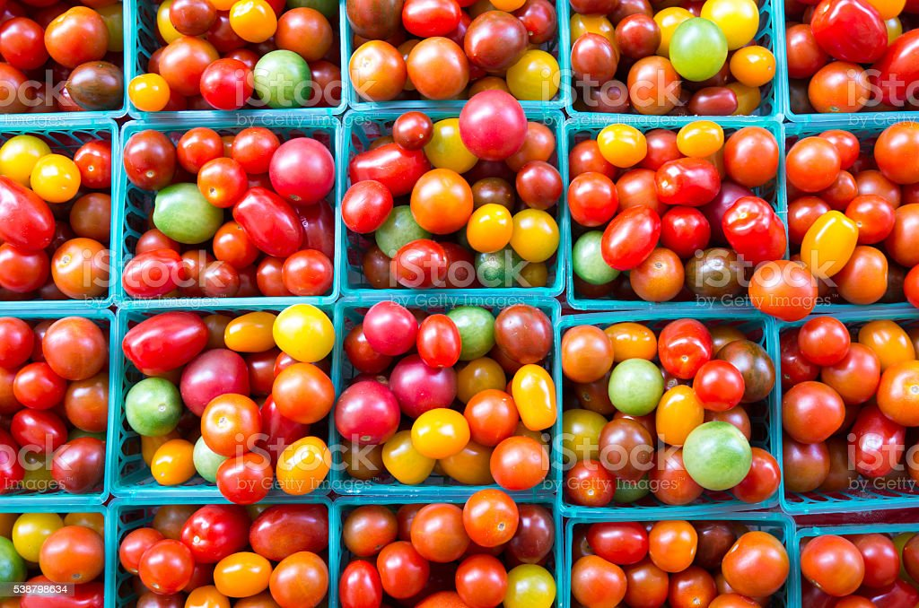 heirloom tomatos for sale in farmers market stock photo