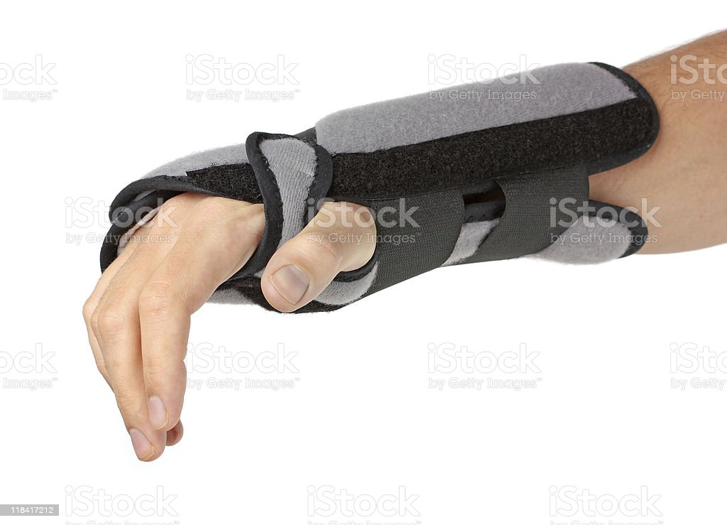 Held out human arm with wrist brace stock photo