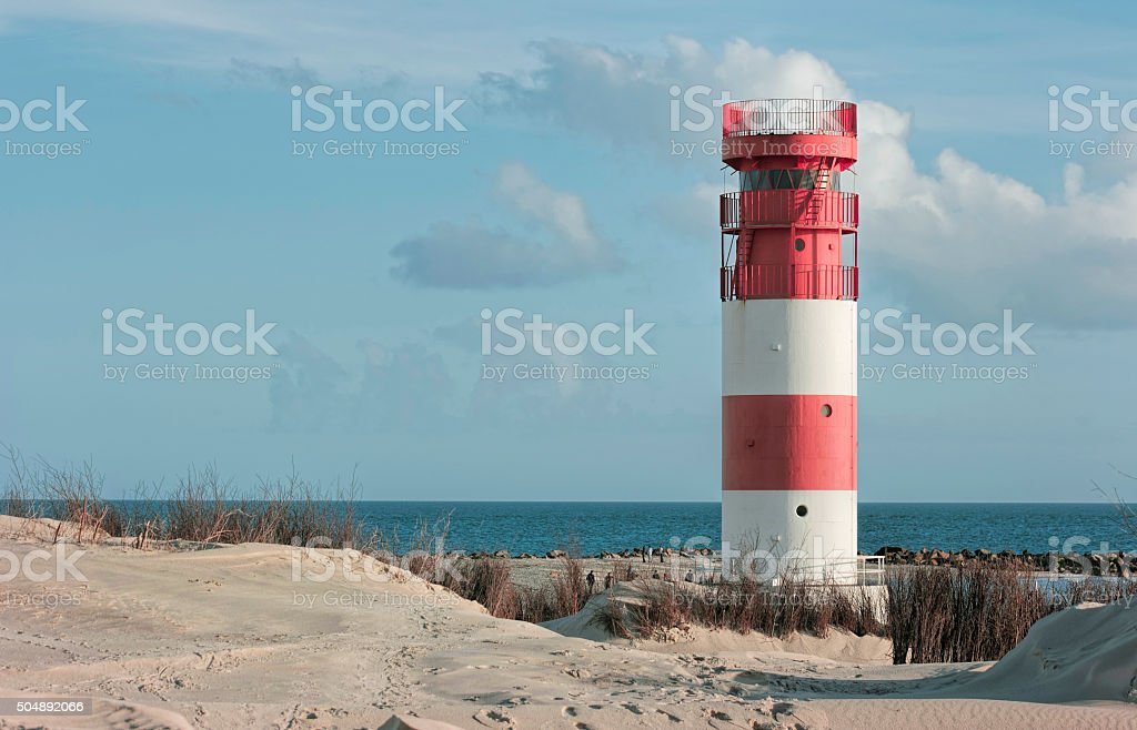 Helgoland Lighthouse between dunes stock photo