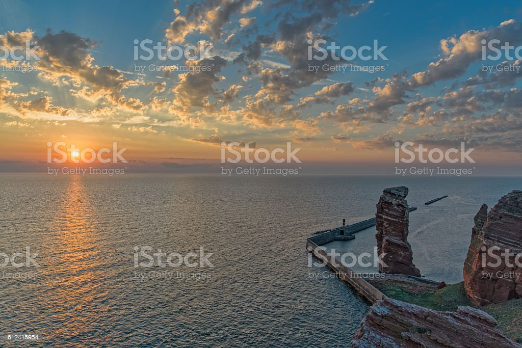 Helgoland rock called 'Lange Anna' with cloudscape at dusk stock photo