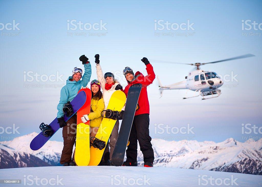 Heli Ski Snowboarders stock photo