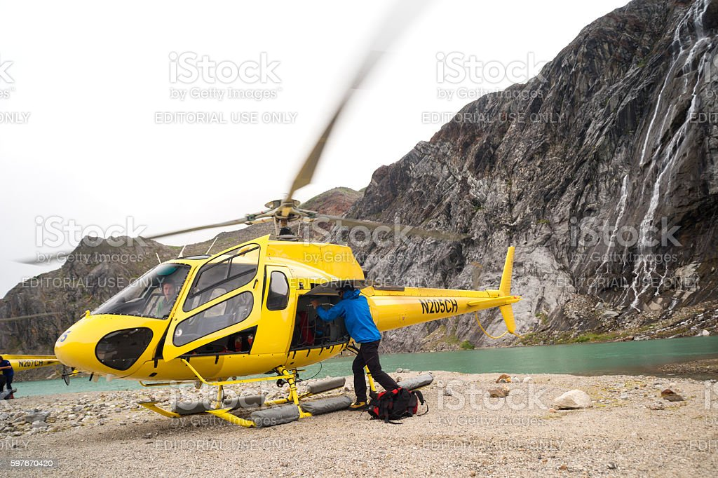 Helicopter adventure on glacier stock photo