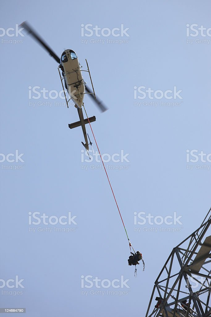Helicopter Airlifting Workmen from Power Line royalty-free stock photo
