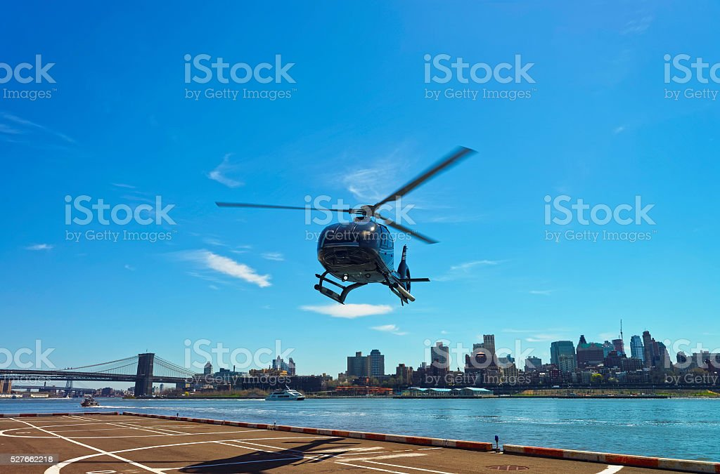Helicopter and Brooklyn bridge and Manhattan bridge over East River stock photo