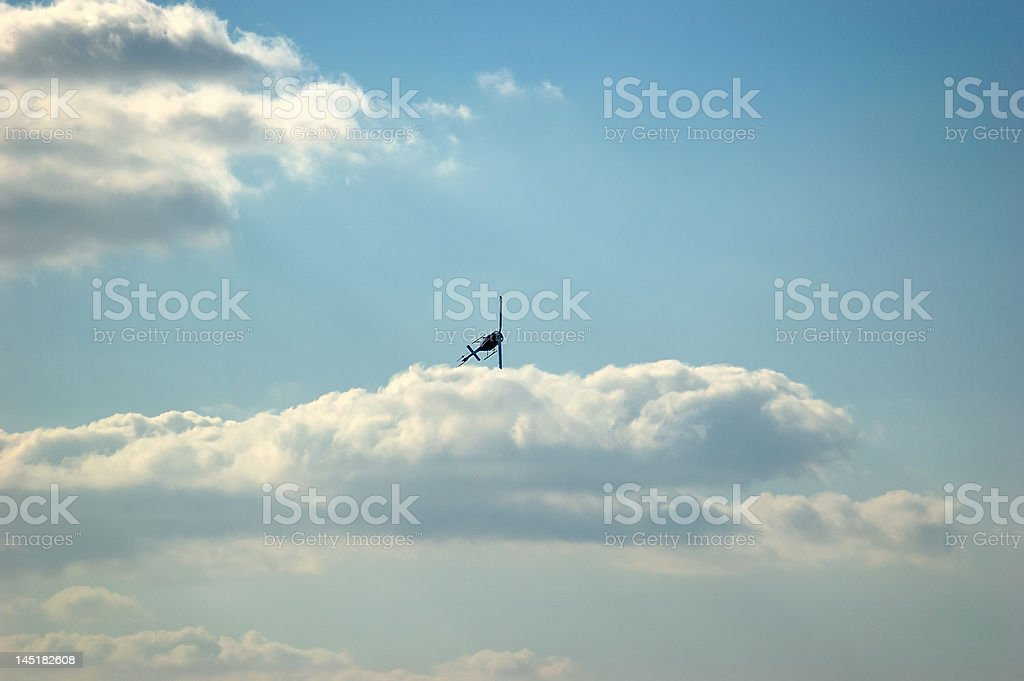 Helicopter and Cloudscape stock photo