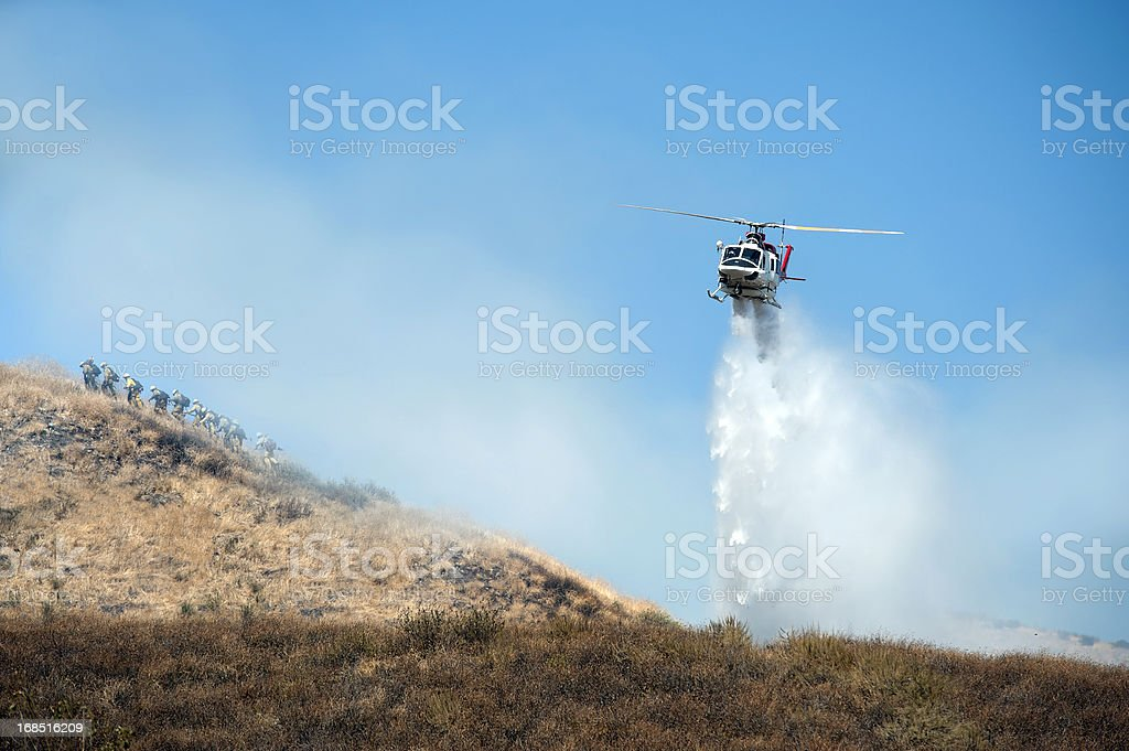 Helicopter and firefighter royalty-free stock photo