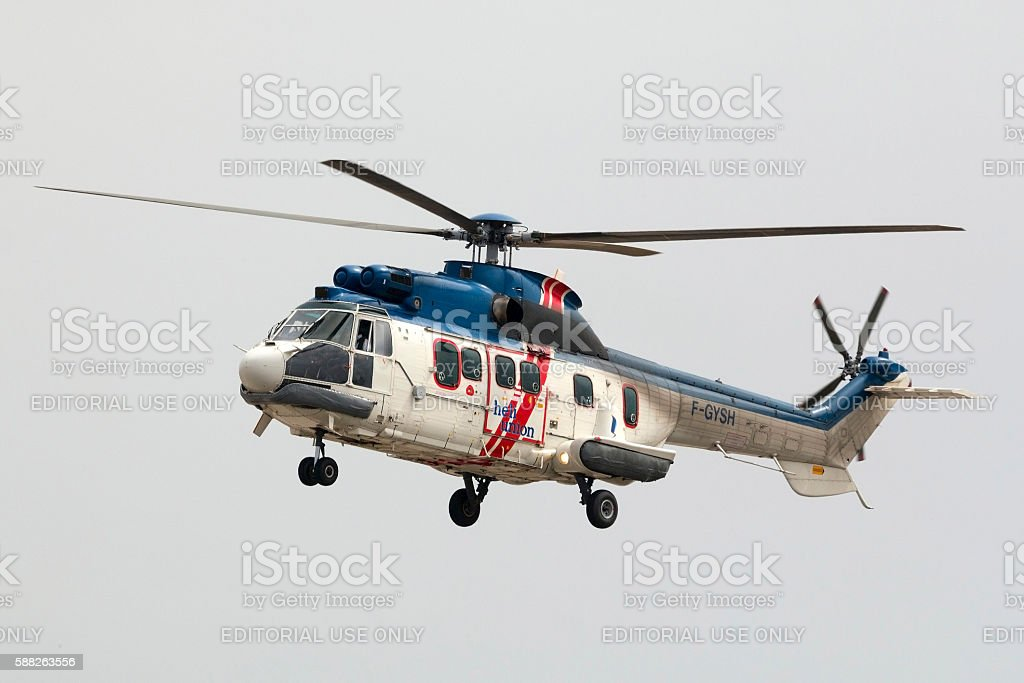 Helicopter arring back from oil rig platform. stock photo