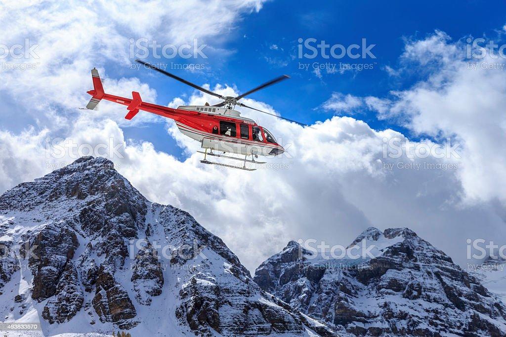 Helicopter at Assiniboine Lodge and Magog Lake stock photo