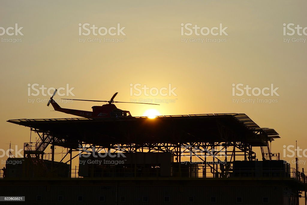 Helicopter at dusk stock photo