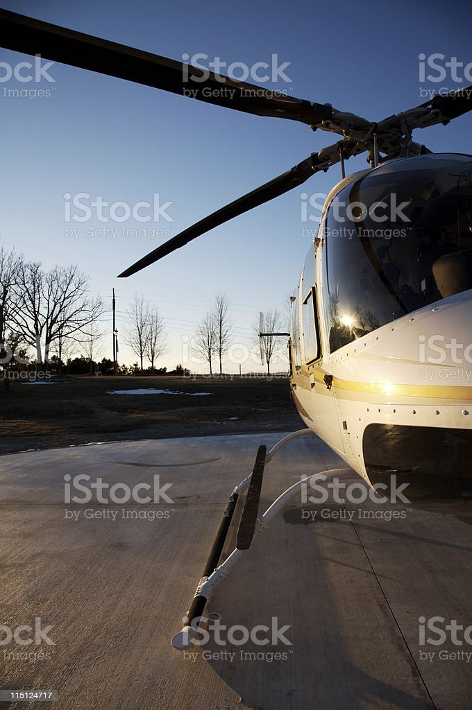 helicopter at sunset stock photo