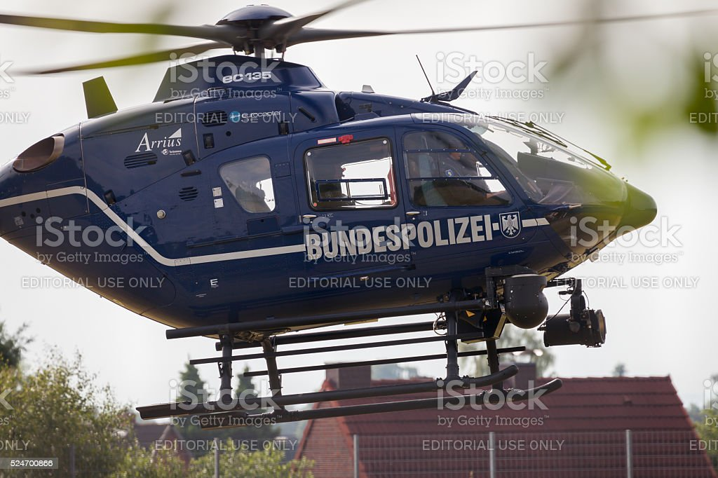 helicopter Bundespolizei lands on a field for a rescue mission stock photo