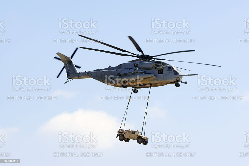Helicopter CH-53 Stallion lifting a hummer stock photo