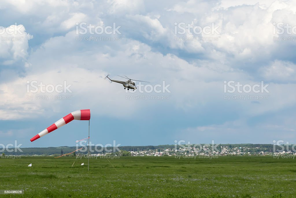 Helicopter comes in to land stock photo