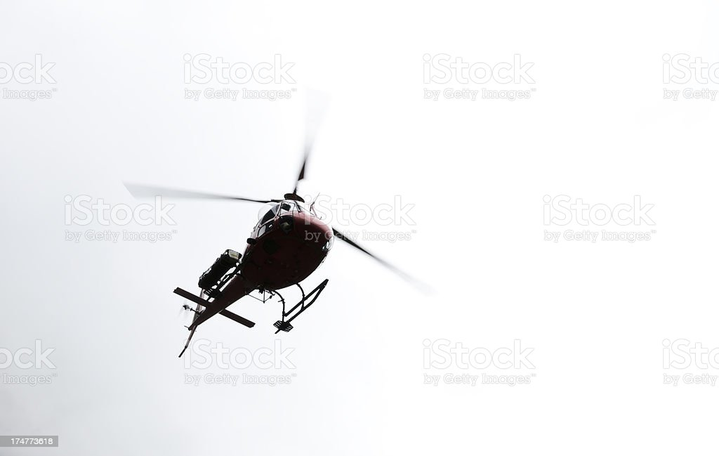 Helicopter coming out of fog royalty-free stock photo