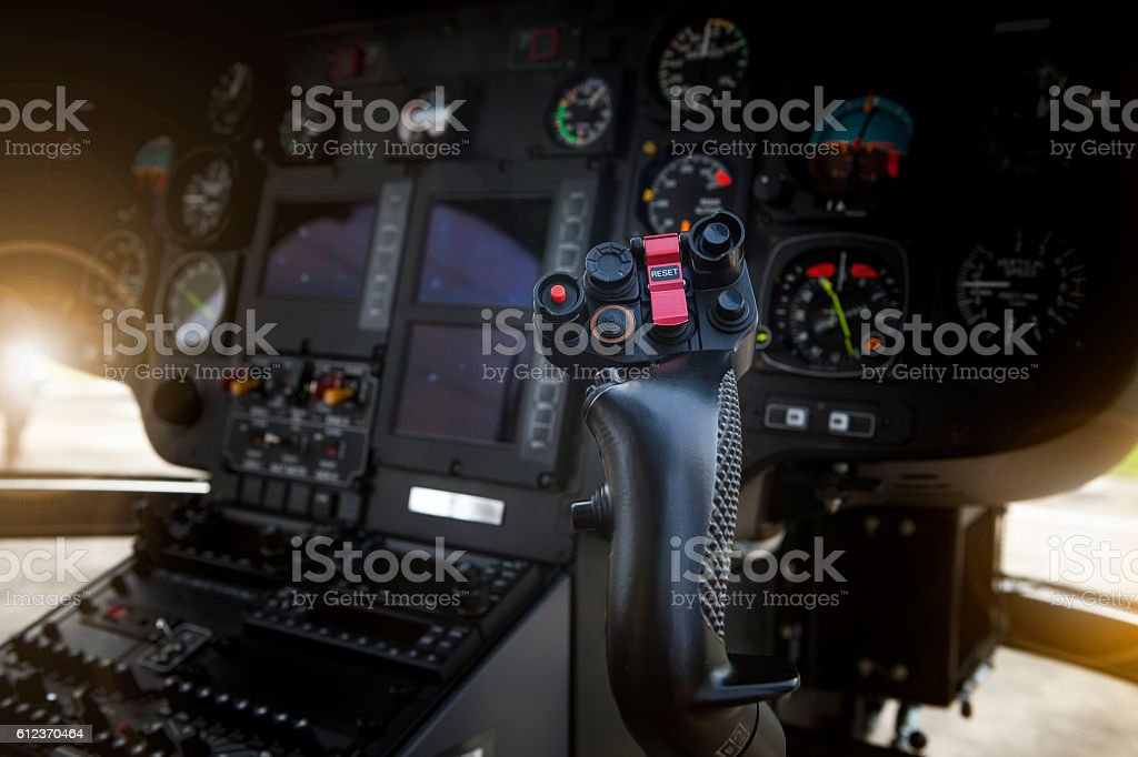 helicopter control stick in side pilot cockpit stock photo