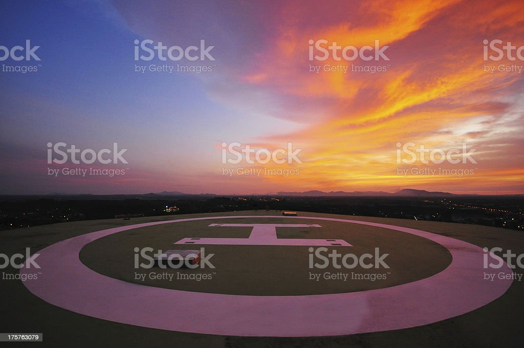 Helicopter deck at sunset stock photo