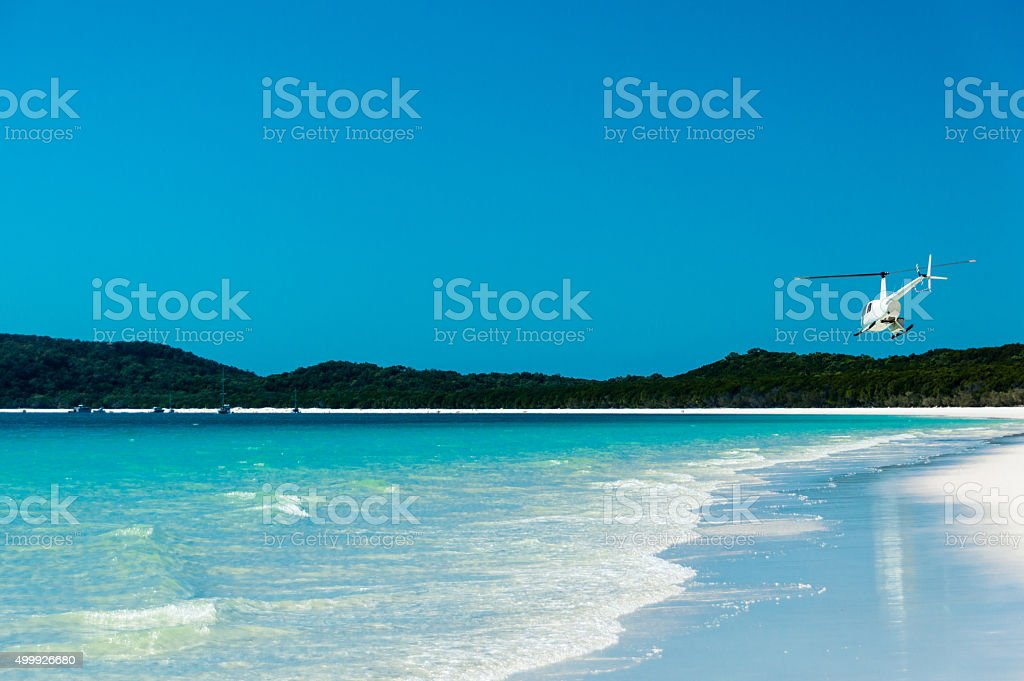 Helicopter departing, Whitehaven Beach I stock photo
