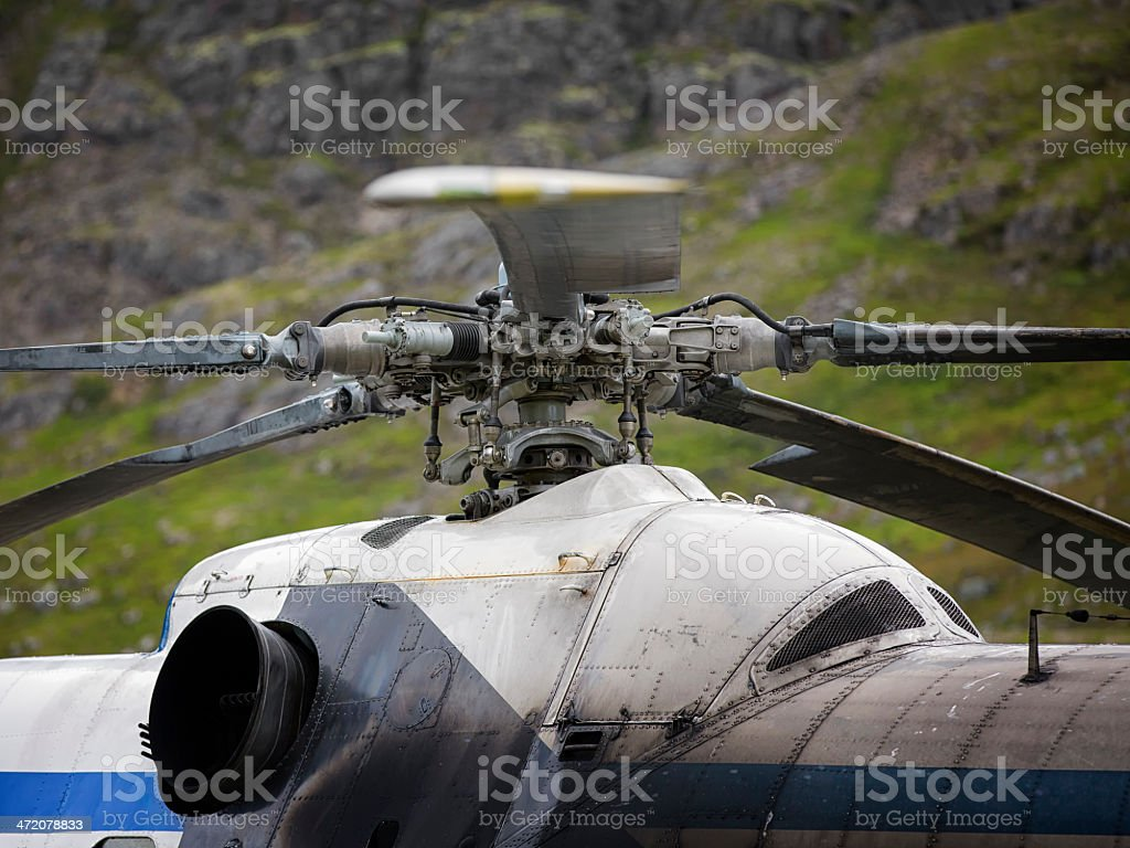 Helicopter detail with mountain in background stock photo