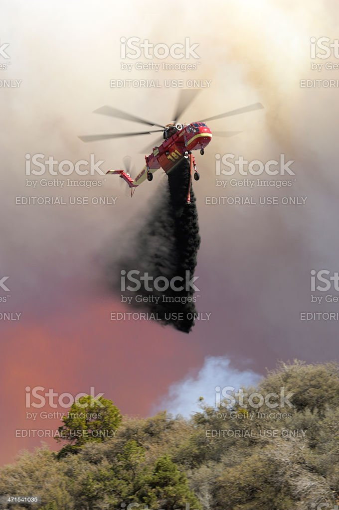 Helicopter Dropping Retardent on Out of Control Wildfire stock photo