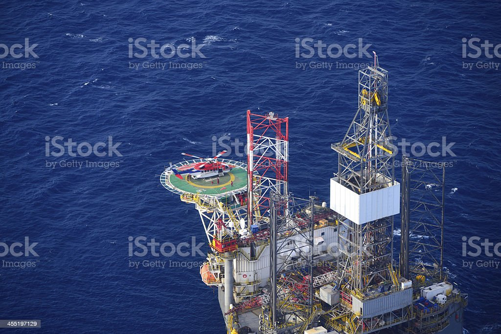 helicopter embark passenger on the offshore oil rig. stock photo