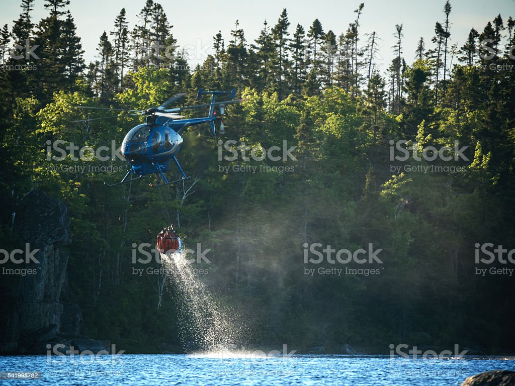 Helicopter Fighting Forest Fire stock photo